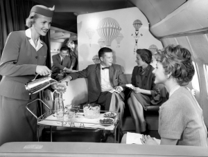 a-pan-am-stewardess-serves-ice-water-and-olives-aboard-the-boeing-707-date-unknown
